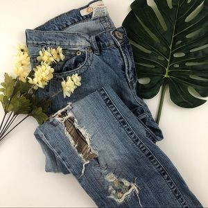 Vintage distressed and patched jeans